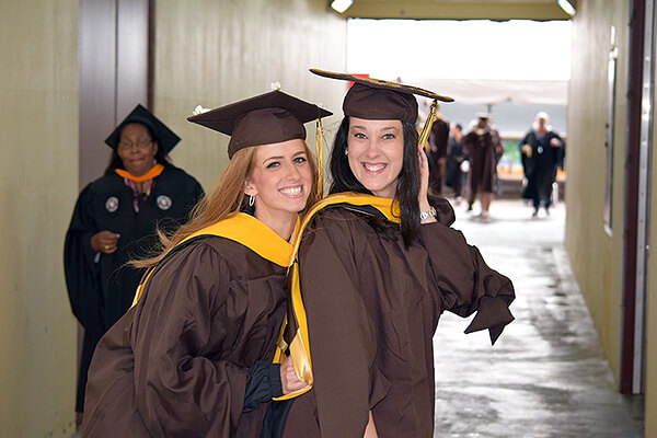Adelphi students posing at graduation