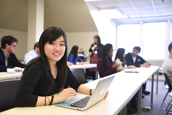 Student studying on laptop at Adelphi University